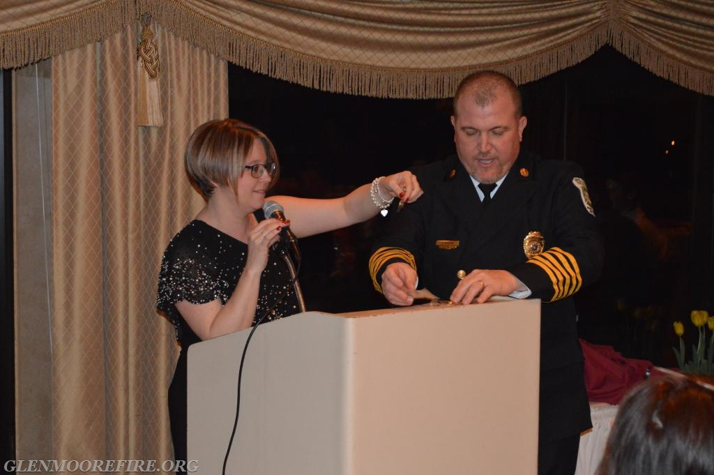 Current Fire Chief Jeff Seese and Secretary Desiree Seese passing out awards.