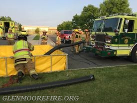 Crews readying the portable tank for water.