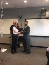 Alexandra DiPaolo receiving her certificate.