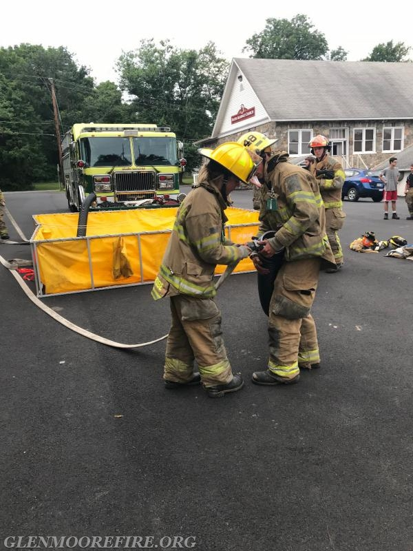 GMFC firefighters making the necessary hose connections.