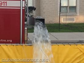 Engine 47-5 unloading its water.