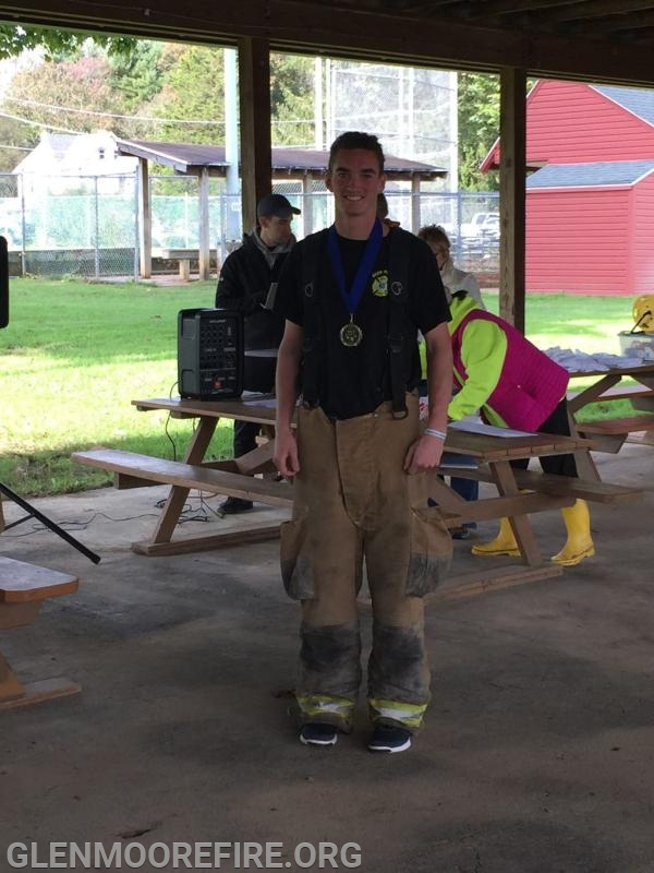 Firefighter Eric Ashenfelter collecting his medal.