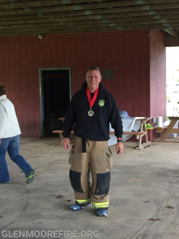 Assistant Chief Andy Chambers taking second place in the fitness challenge.