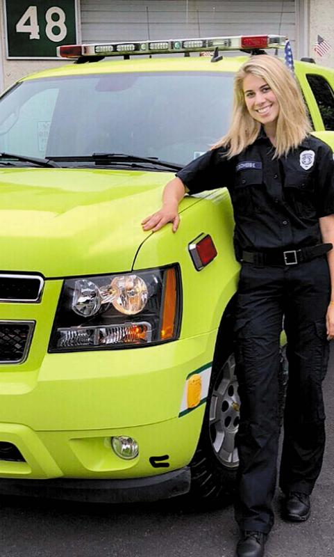 FF/EMT Cassidy Scheibe with the QRS 48 squad vehicle.
